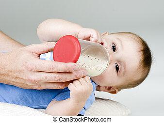 Baby Sucking on Bottle