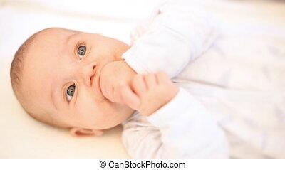 Baby sucking thumb. Teething.