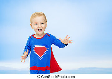 Baby Superhero, Kid Man in Blue Super Hero Costume, Happy Child Boy Superman on Sky Background