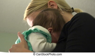 Baby Swaddled to Calm - A precious baby is held and cared...