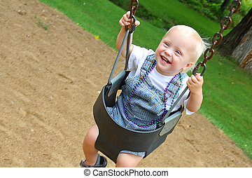 Baby Swinging at Park