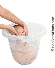 Baby taking a bath in bucket