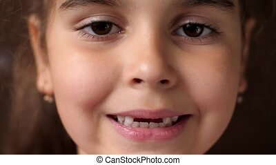 Baby teeth. Toothless smile. Cutting root tooth. The girl ...