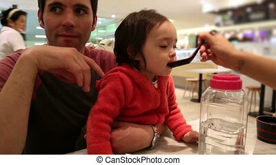 Baby Toddler 11 Eating with Uncle - 11) Video of baby and...