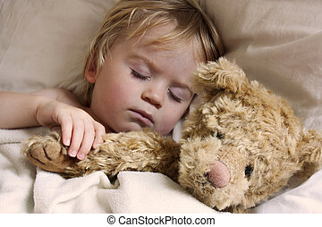 baby toddler asleep with teddy bear - cute young baby...