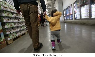 1) Glidecam video shot of baby Korean toddler in a big warehouse store with uncle.