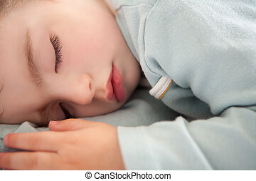 baby toddler sleeping closed eyes relaxed