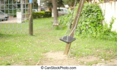 Baby Toddler Swinging on the Park