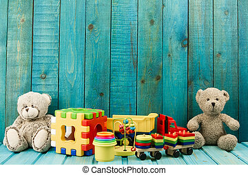 Baby toys on turquoise wooden background