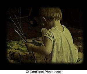 baby try to make art