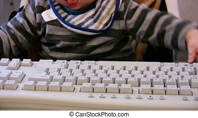 Baby typing on computer keyboard 2
