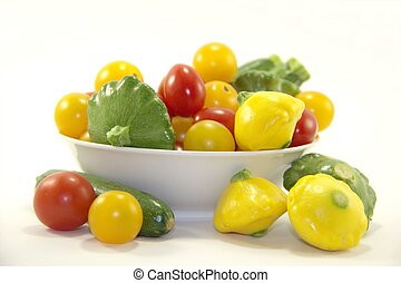 Baby vegetables in white plate