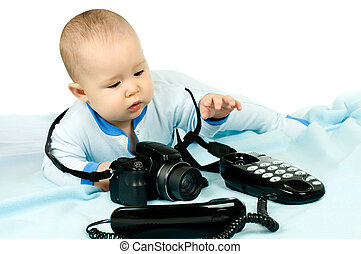 baby - very little kid , lie on stomach and play with camera...