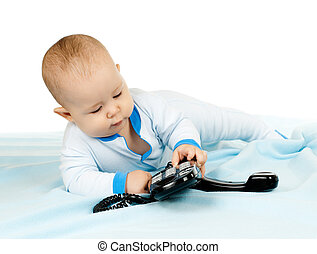 baby - very little kid , lie on stomach and play with phone...