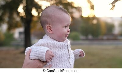 Baby walking in the park with father