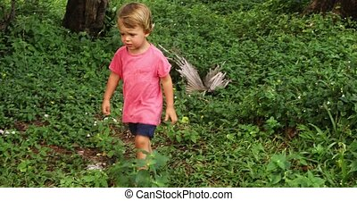 Baby walking through path in exotic jungle