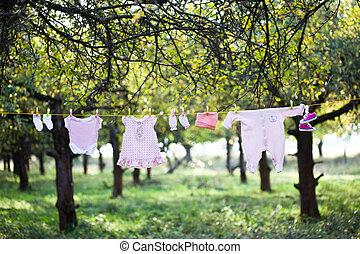 Pink baby wear outdoor in garden