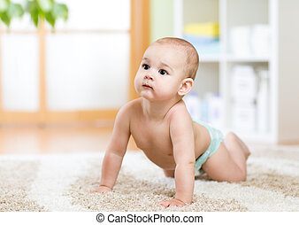 baby weared in diaper crawling on floor
