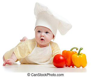 baby wearing a chef hat with healthy  food vegetables, isolated on white