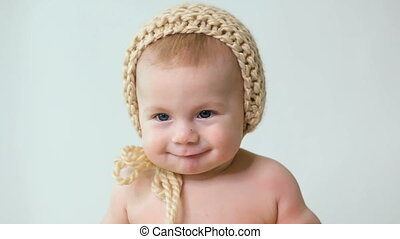 baby wearing a hat-knitting