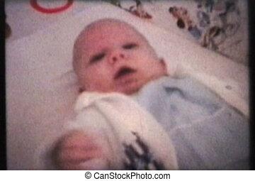 Baby Wearing New Sweater (1962) - A cute little boy lays in...