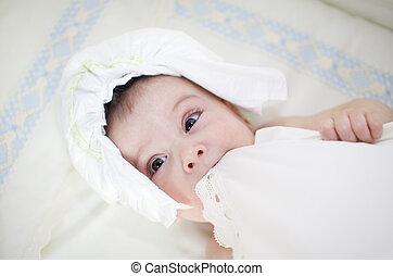Baby wiith diaper hat.