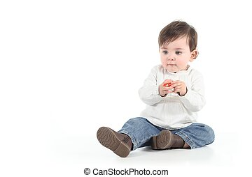 Baby with a candy in her hands