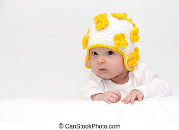 Baby with a knitted hat