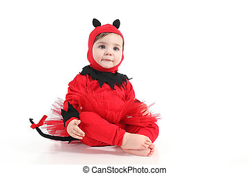 Baby with a red demon disguise on a white isolated background
