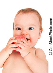 baby with apple - cute little baby looking into camera and...