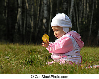 Baby with autumn leaves