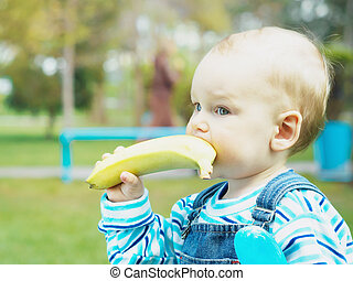Baby with banana