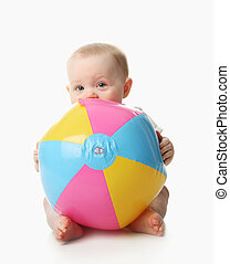 Baby with beach ball