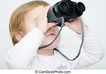 Baby with binoculars, closeup