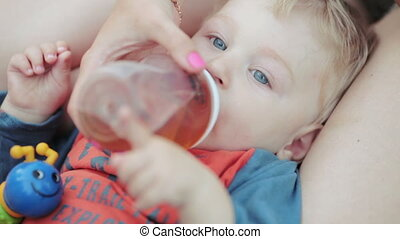 Baby with bottle in countryside