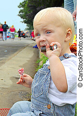 Baby with Candy at Parade