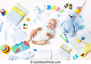 Baby with clothing and infant care items