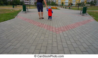 baby with dad walking in the park