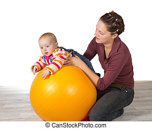 Baby with delayed motor activity development being supported...