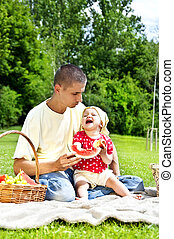 Baby With Father On Picnic