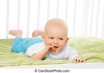 Baby with itching gums - Little baby boy itching gums with...