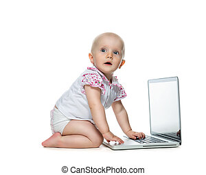 Baby with laptop on the white