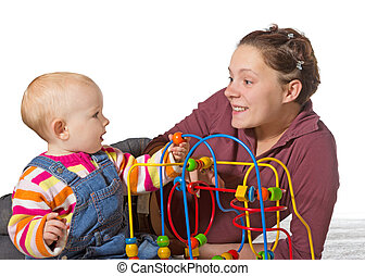 Baby with motor activity development delay being stimulated...