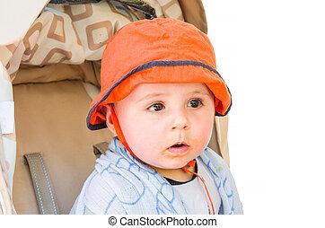 Baby with orange cap