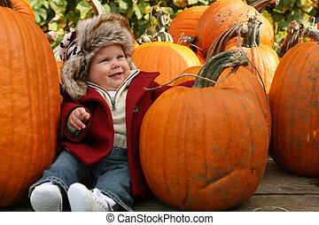 Baby with pumpkins - Little baby amongst pumpkins