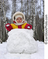 baby with snowball
