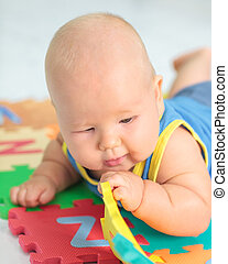 Baby with toy - Cute baby is playing toy