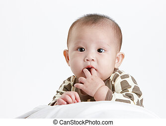 baby wondering - baby with a funny expression, studio shot