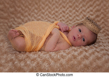baby wrapped in muslin with crown