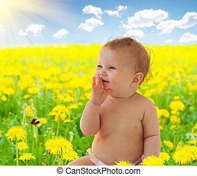 Babygirl sitting among dandelion collage